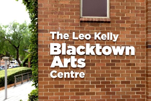 brick wall with white text that states: The Leo Kelly Blacktown Arts Centre