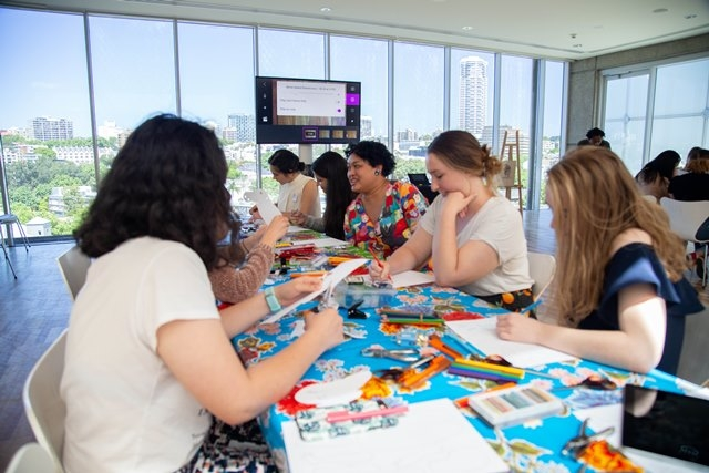 Group of adults doing an art workshop at a table