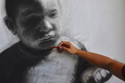 Hand drawing with charcoal a black and white drawing of a baby