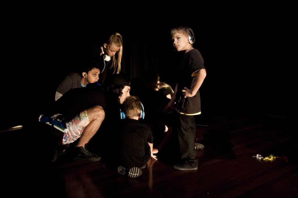 Group of children in a circle working on a project