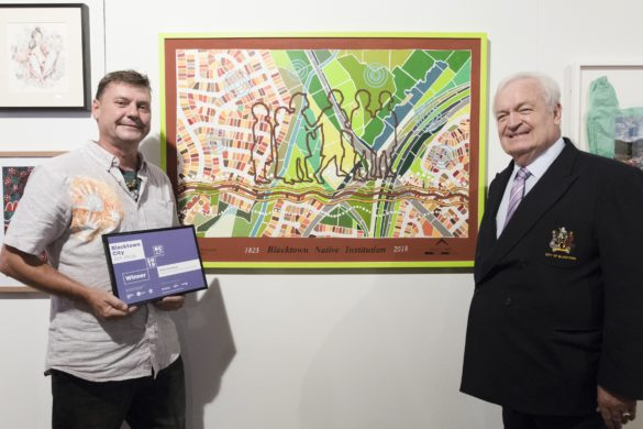 ArtistJamie Eastwood standing to the left of his artwork and the mayor standing to the right