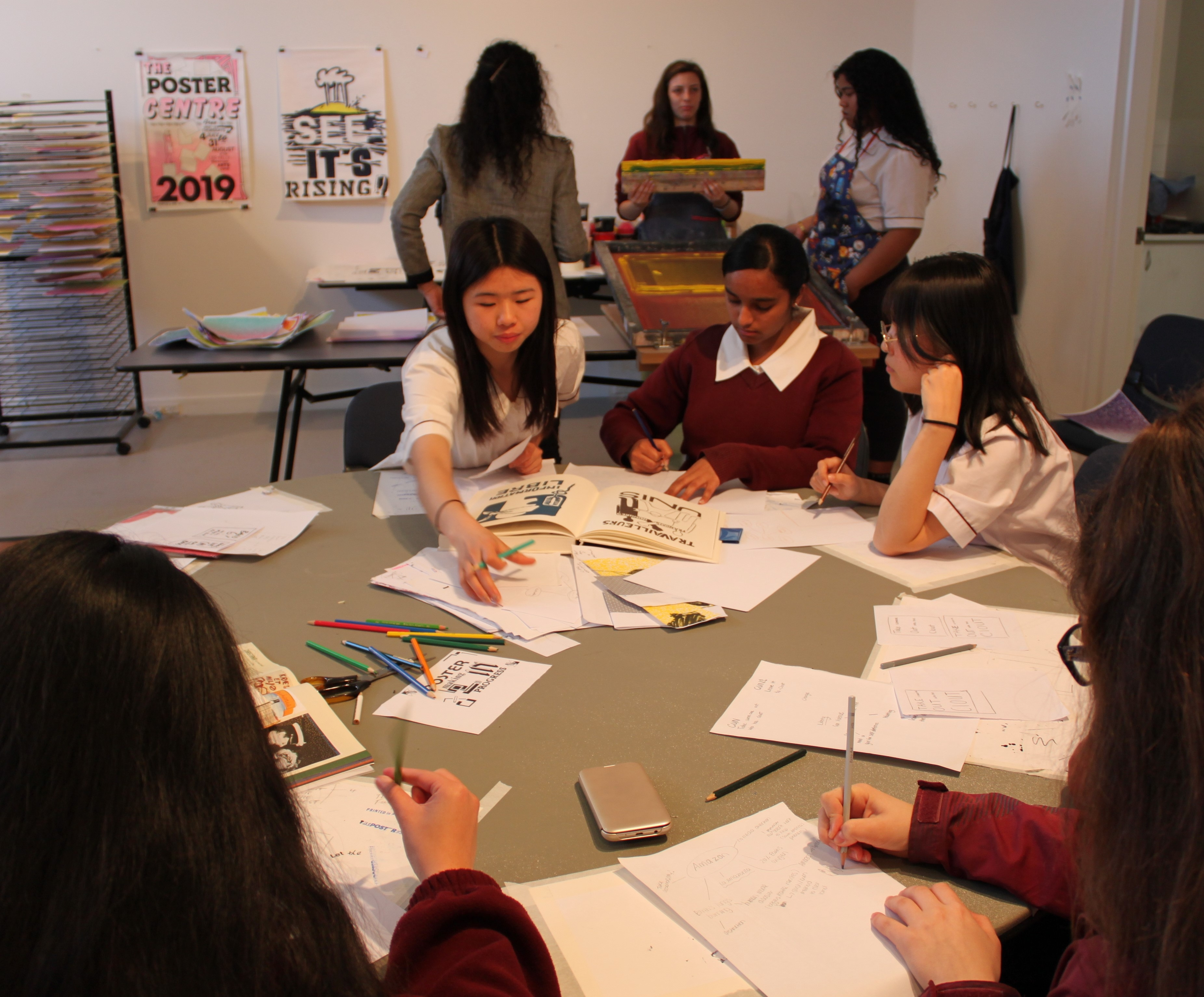 Group of high school students working on creative projects