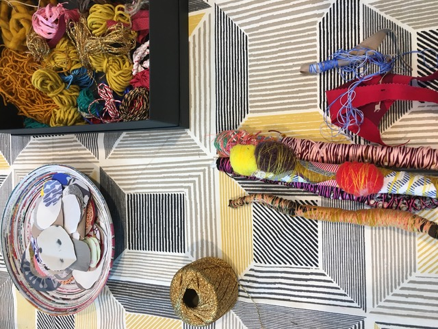 Flatlay of textile work by Paula do Prado