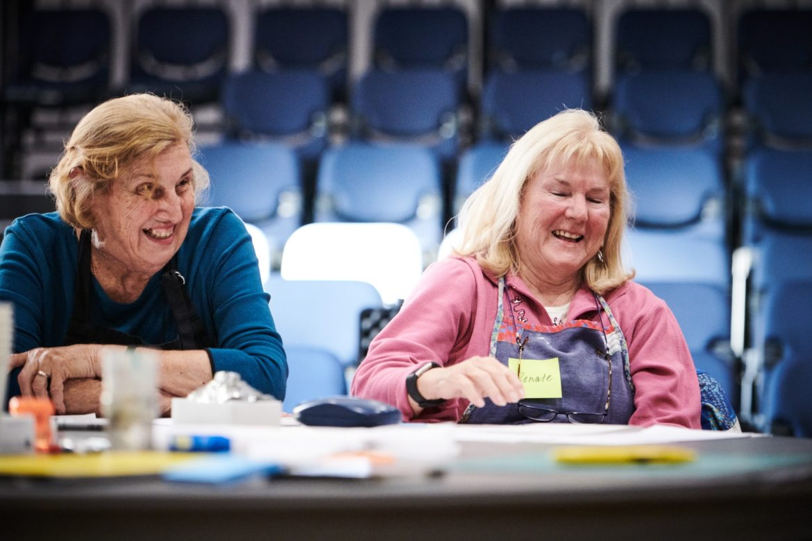 Two women laughing at a workshop