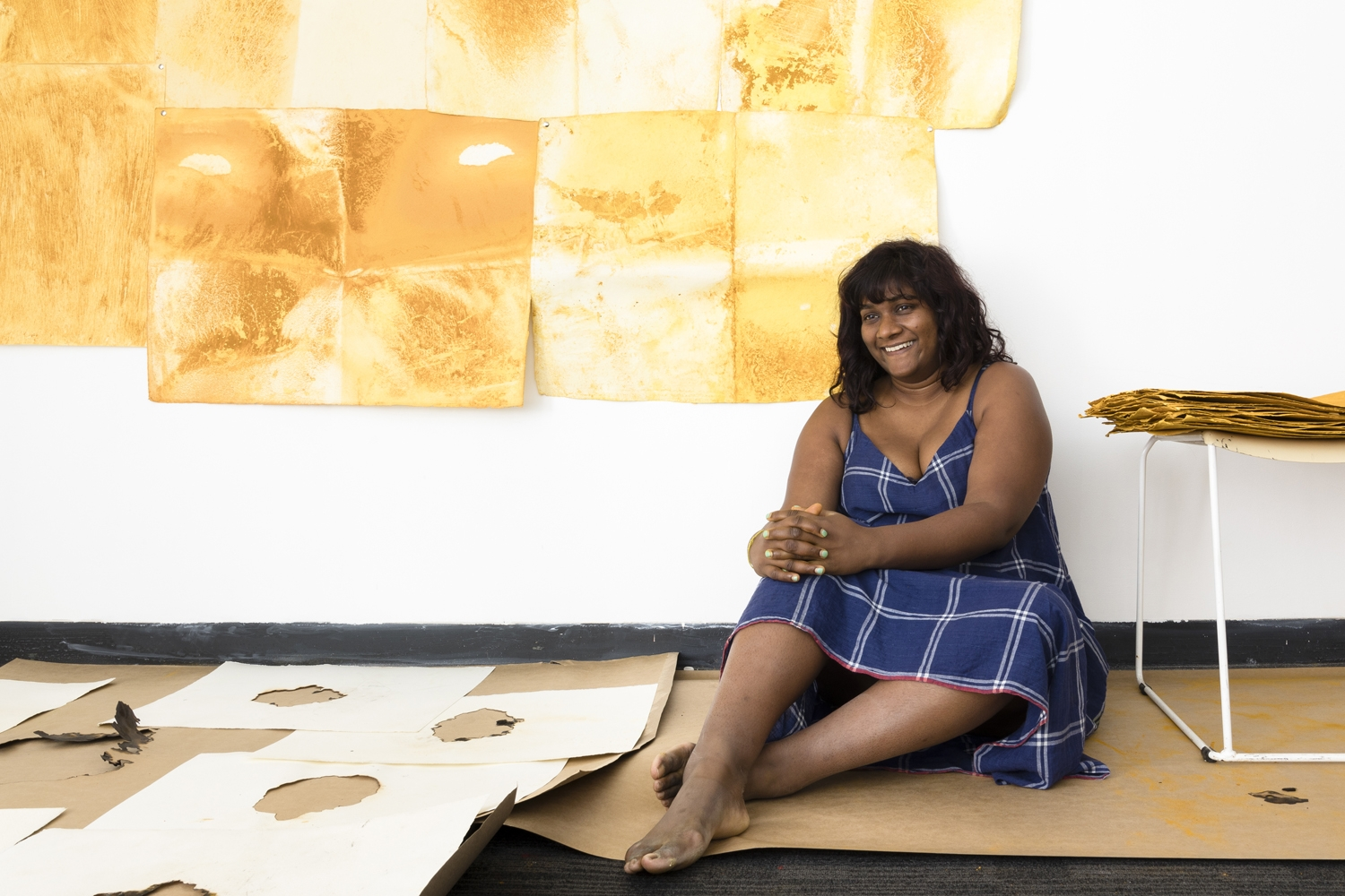 Shivanjani Lal sitting in front of her work for Terra inFirma in her studio