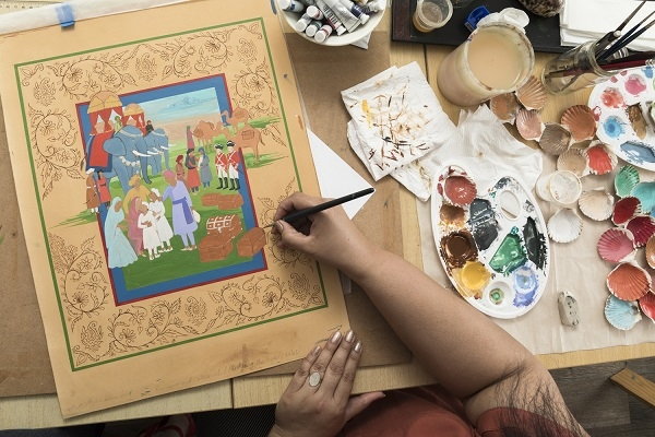 Close up image of Fozia Zahid working on a miniature painting