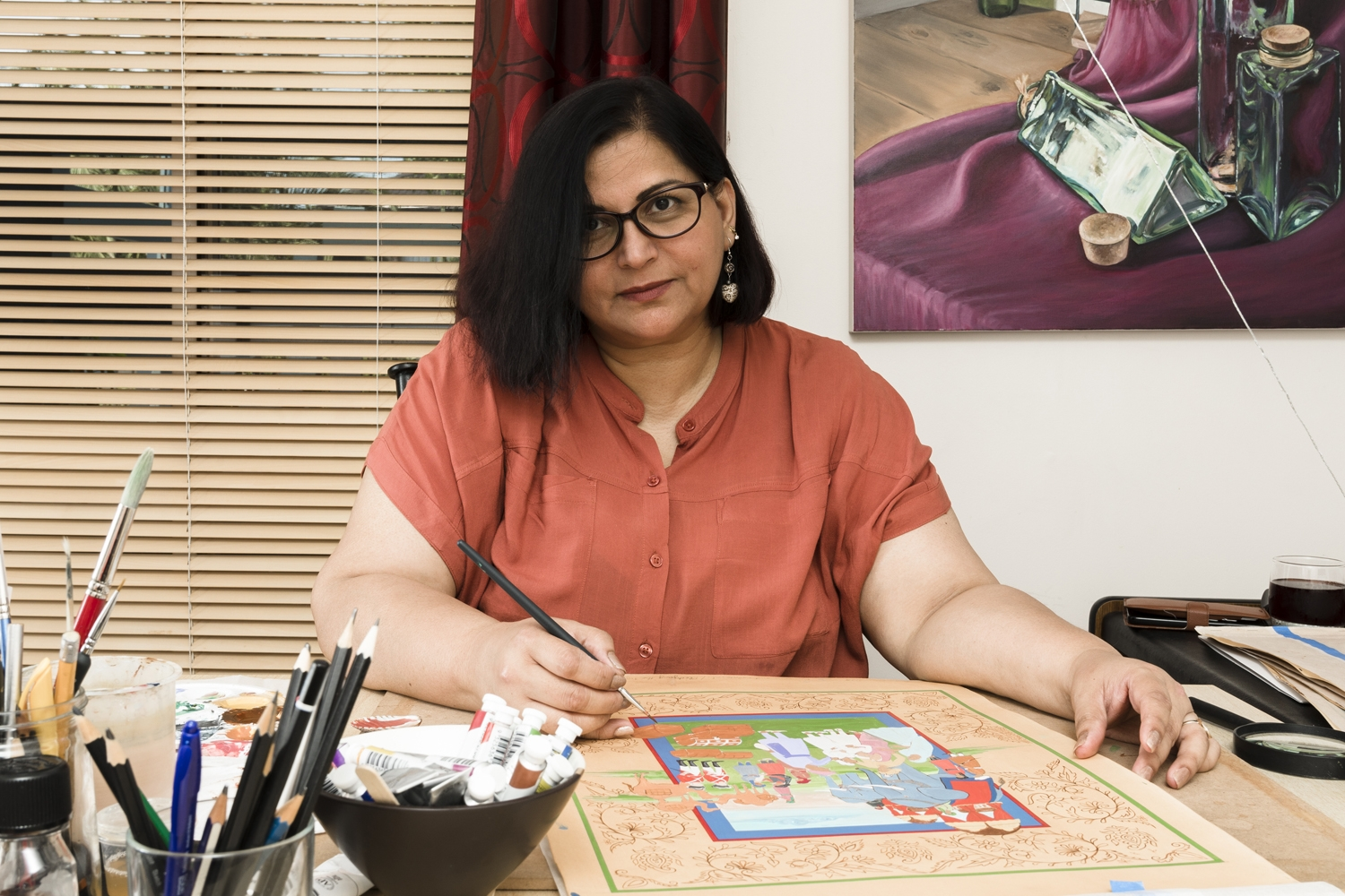 Fozia Zahid working on a miniature painting in her studio